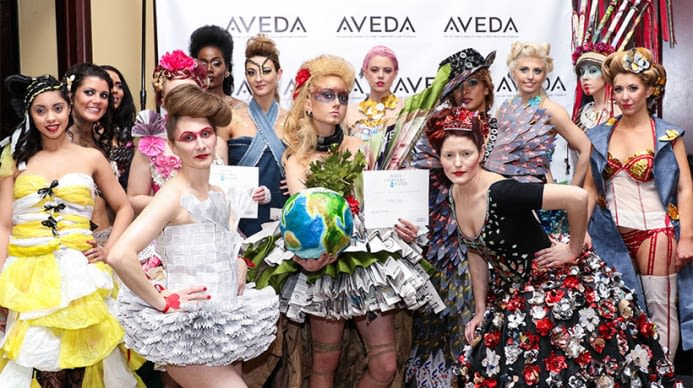 A group of Aveda models during an earth ay event, dressed in recycled clothing