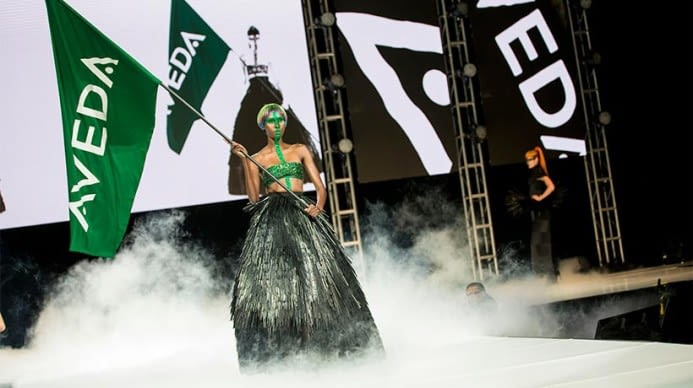 The lead model at the 2016 Aveda earth ay show carrying the aveda flag