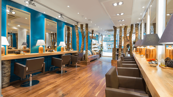 The inside of a salon, it is rustic, and full of nature.