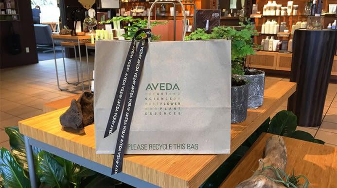 An Aveda gift bag on a table