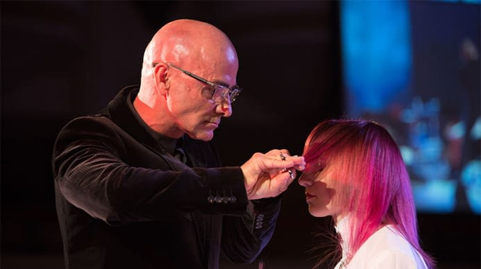 An artist displaying skills at the inter coiffure event