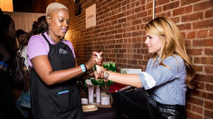 Aveda artsit giving a client a hand massage