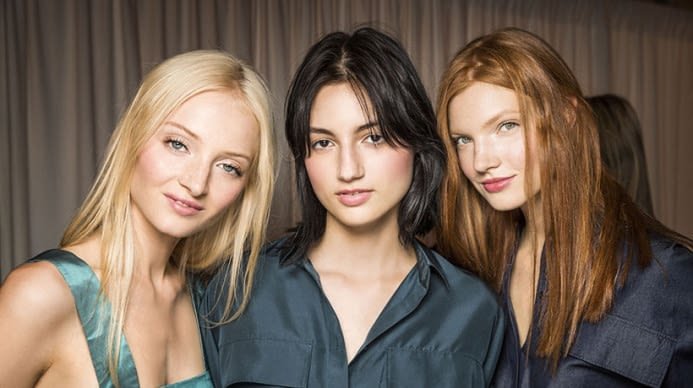 Three aveda hair models with different hair colors