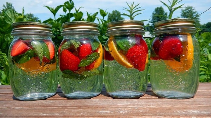 Mason jars filled with fruit and water