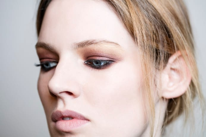 blonde woman with natural aveda brand eye shadow