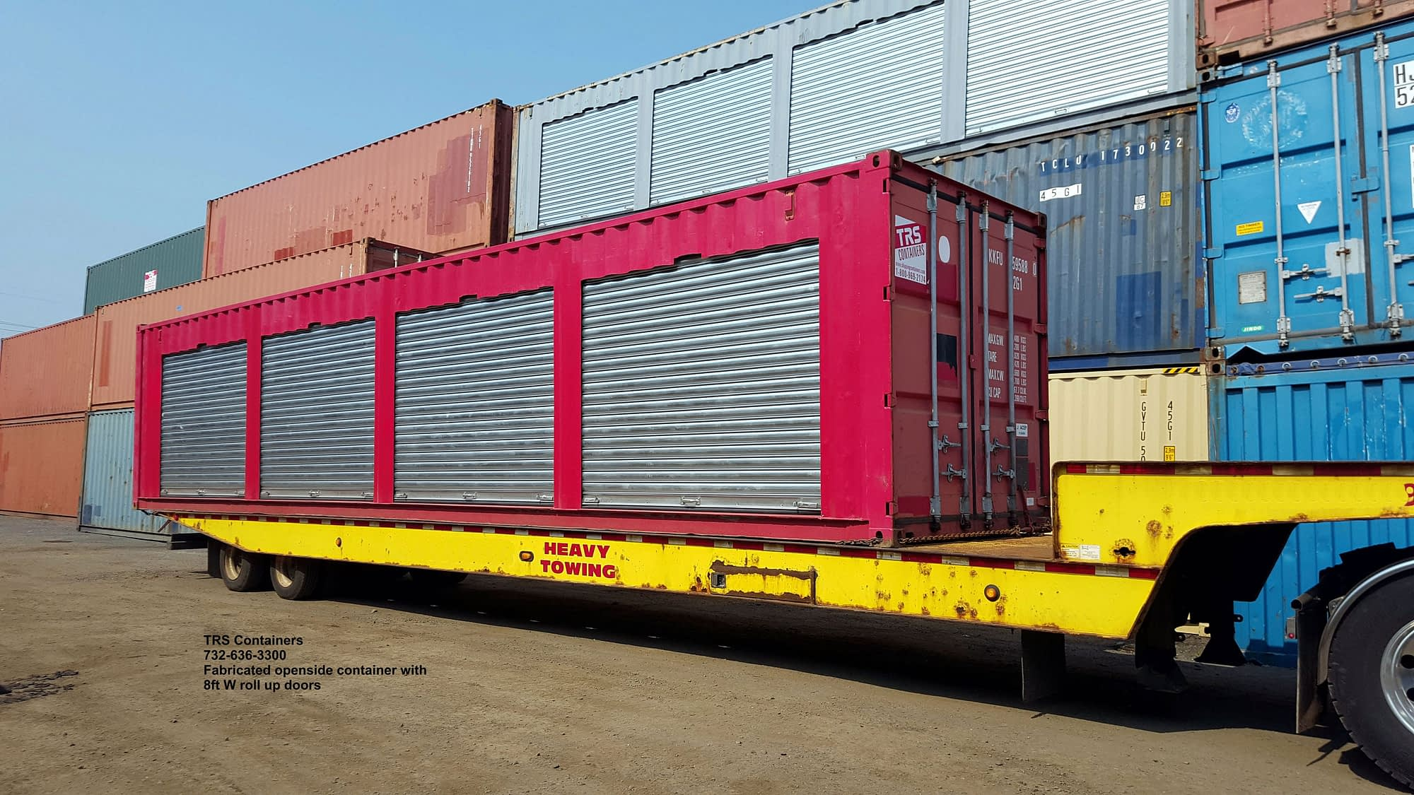 TRS Containers adds heavy duty 20 gauge roll up doors and ships out on a tiltbed truck