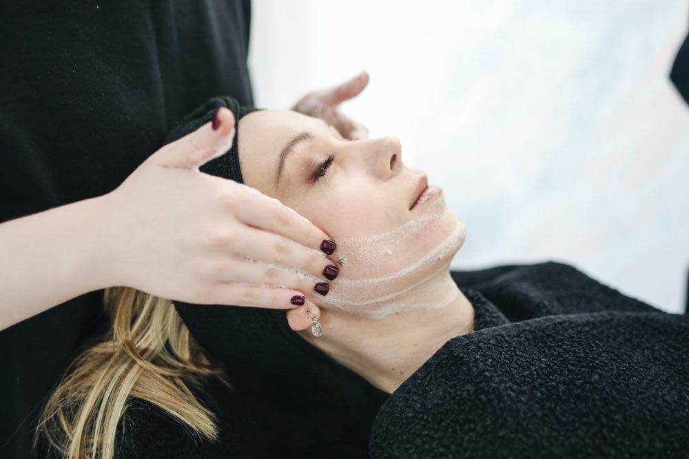 Woman getting a facial at a spa.