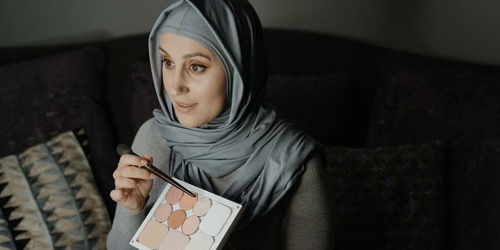 woman looking at a makeup pallette