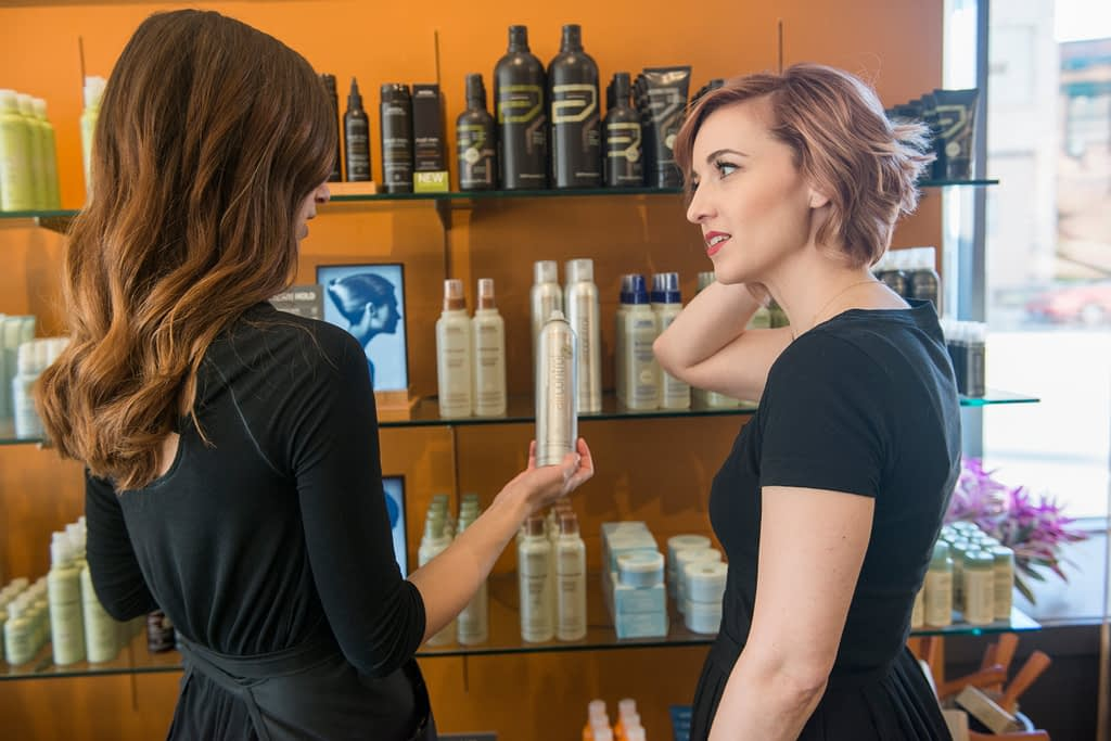 showing a girl products on a shelf