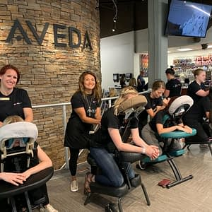 Aveda Institutes Denver Students Providing Massage Therapy
