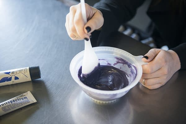 woman mixing up a bowl of hair color