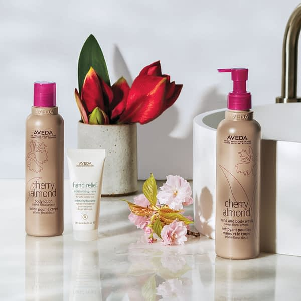 Aveda bottles on display with flowers