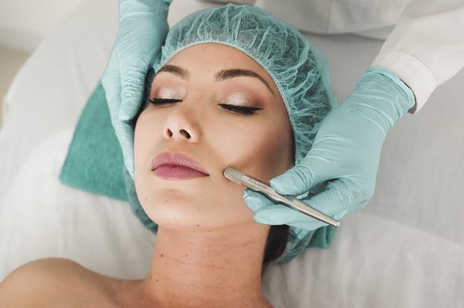 Woman receiving a facial.