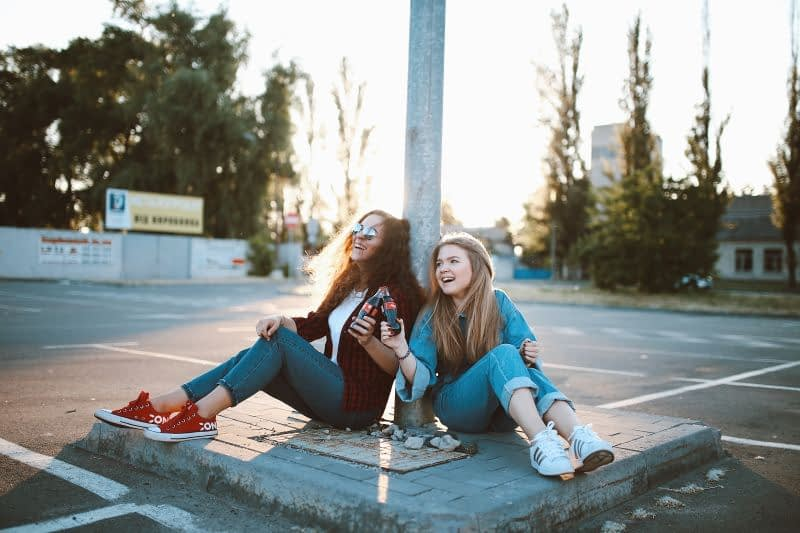 girls laughing in a parking lot