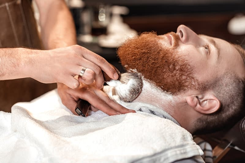 Man getting a beard shave