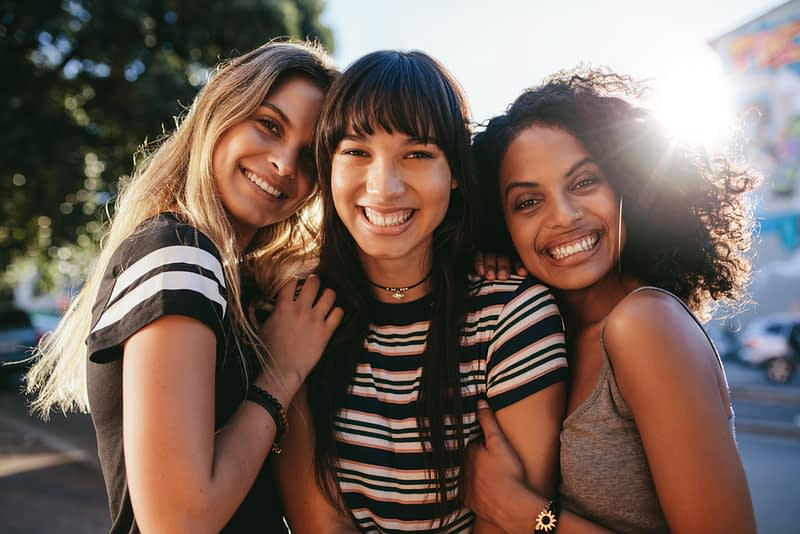 3 girls smiling
