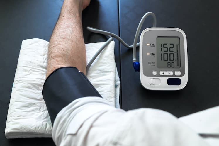 Hypertensive patient performing a blood pressure auto test