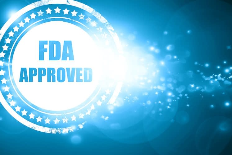 Blue stamp on a glittering background: FDA approved background