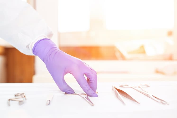Doctor takes medical instruments from the table for the concept of transplantation of human organs and tissues, transplantology