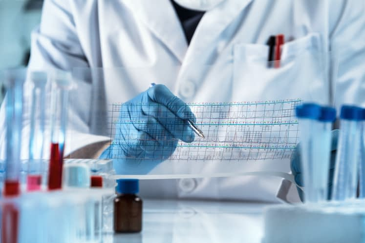doctor analyzing DNA sequence results analysis graph