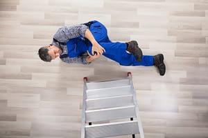 injured man by ladder