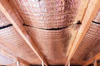 Radiant heat barriers between attic joists