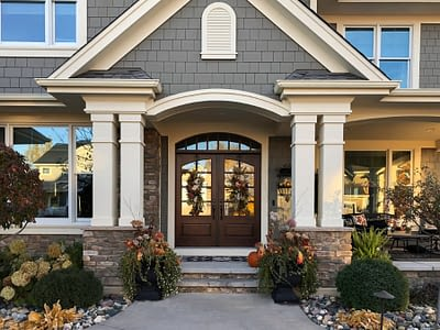 Large Double Exterior Doors Surrounded By Pillars