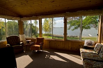 Lakeside enclosed porch with furniture