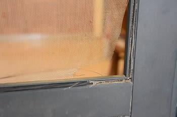Torn corner of screen door