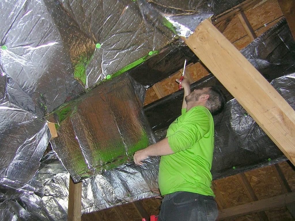 Man inspecting attic