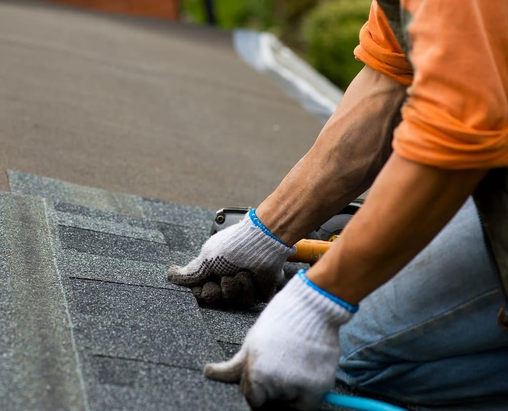 Roofer Installing Shingles