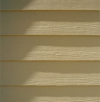 Close detail of painted engineered wood siding