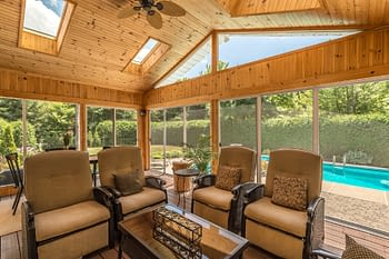 Enclosed porch overlooking pool