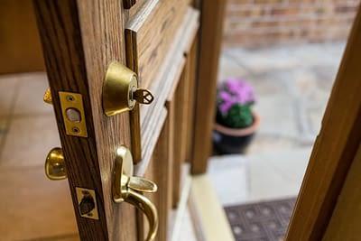 Wooden Door Left Open with Key in Lock