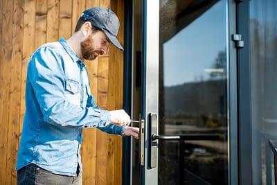 Contractor replacing door lock