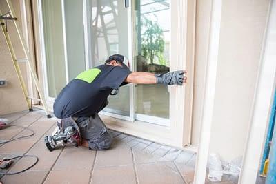 Handyman installing storm door