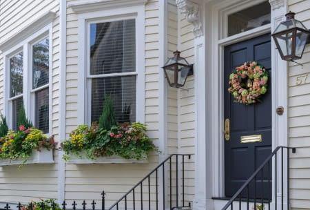 Front Of House With Blue Door And Flower Wreath