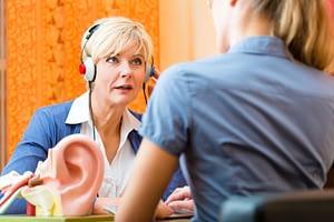 woman taking hearing test