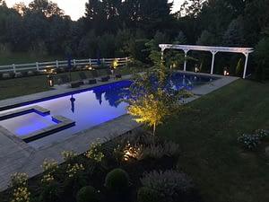 Long custom designed pool lit for the evening
