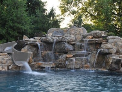 Swimming Pool with Slide and Water Feature