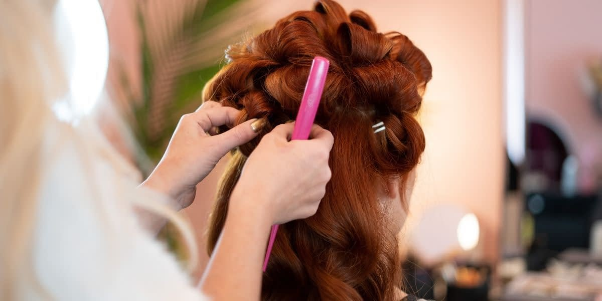 red-haired-girl-getting-hair-curled-at-palos-hills-salon
