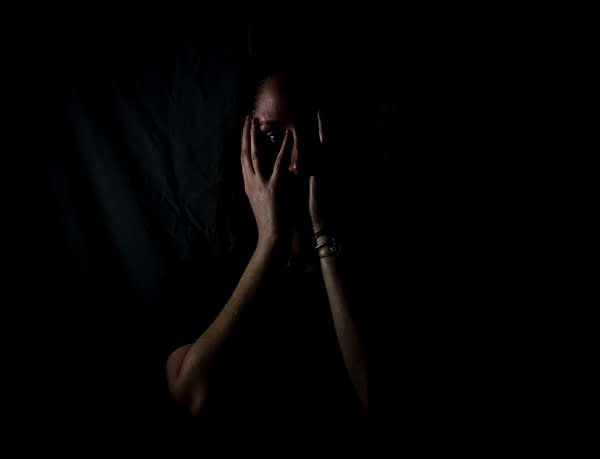 Woman in a dark room scared