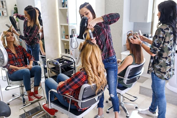women working together in a hair salon