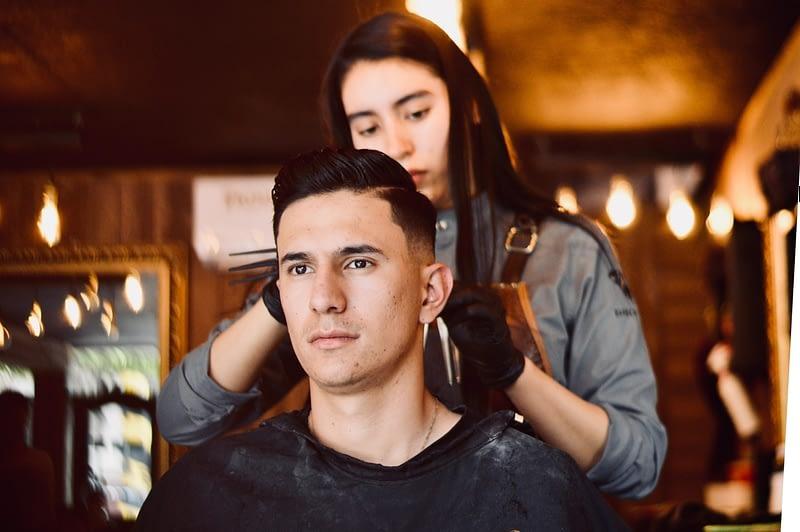 getting a haircut in a salon