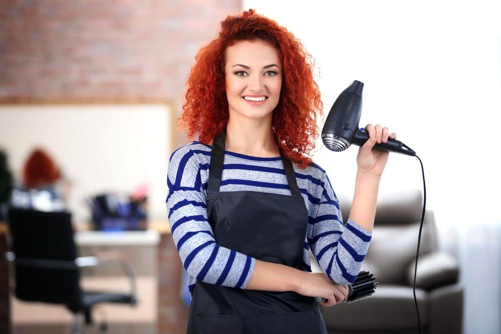 hairdresser with blow dryer