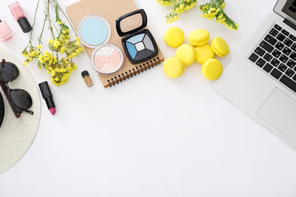 Layout of makeup and laptop