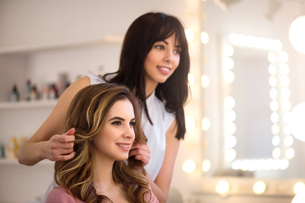 woman getting her hair done by a stylist