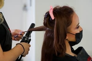 student curling guest hair