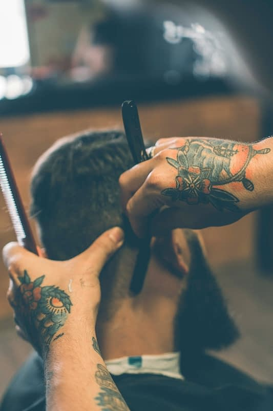 man getting neck shaved at a barber shop