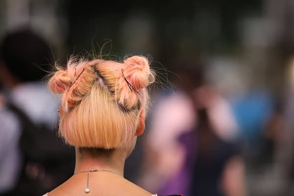 back of woman's head who has pink hair